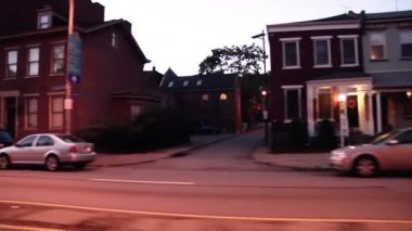 Driving at dusk in a Pittsburgh suburb. — Stock Video