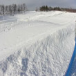 Стоковое видео: Riders slide down snow tubing hill.
