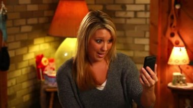 A young woman video chats on her mobile smartphone.