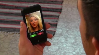 Video chatting on a generic, portable handheld device. — Stock Video