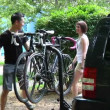 Stock Video: A young couple bike and sightsee on the bike trails