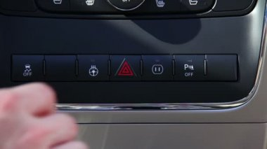 Pushing the hazard lights button on a car's dashboard. — Stock Video