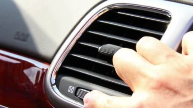 Close-up of adjusting the vents on a vehicle's dashboard. — Stock Video #15841999