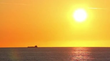 A freighter ship on the ocean during a sunset. — Stock Video