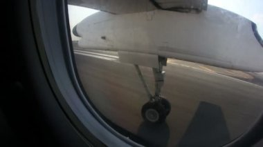 The wheels retract on a propeller airplane as it takes off. — Stock Video
