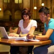 Stock Video: Students meet and study in a great hall at a large university or college