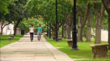 Students meet and walk on a college campus.