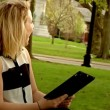 Using iPads in the Park - Stock Photo
