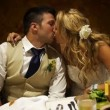 Bride and Groom Kiss - Stock Photo