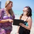Woman with iPad at Beach — Stock Video #25952731