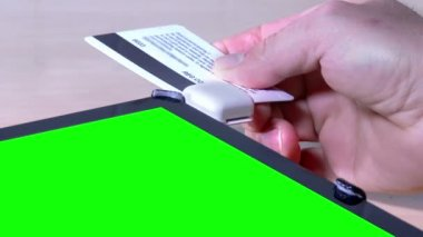 Swipe Credit Card on Green Screen Tablet PC — Stock Video