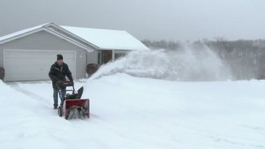 Man Uses Snowblower — Stock Video