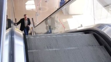 Businessman on Escalator — Stock Video
