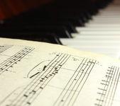 Notes on piano keys — Stock Photo