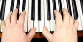 Hand on piano keys — Stock Photo