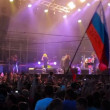 Fans with russiflag at live performance of rock band Bi-2. Defocus. — Stock Video #31443695