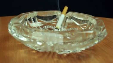 Cigarette in glass ashtray — Stock Video