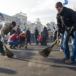 Stock Photo: Volunteers cleaning Independence square in Kiev after victory of revolution