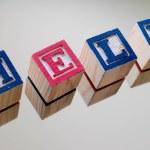 Child's blocks spelling help — Stock Photo