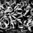 Dozens of old black and white tires — Stock Photo