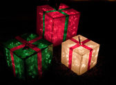 Red, green, and white lighted gift boxes for Christmas — Stock Photo