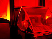 Juke box in a red lit room — Stock Photo