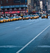 A street with a long line of taxis in New York. — Stock Photo