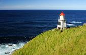 White lighthouse on the seashore — Stock Photo