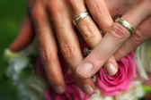 Hands together with wedding rings — Stock Photo