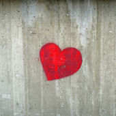 Red hearth on the concrete gray wall — Stock Photo
