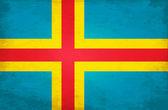 Grunge vlajka alandské ostrovy — Stock vektor