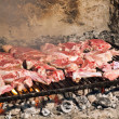 Raw meat on grill — Stock Photo