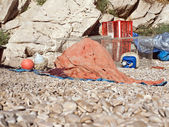 Fishing net and traps on beach — Stock Photo