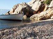 Small boat on the beach — Stock Photo