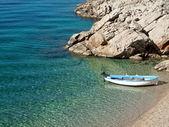 Small fishing boat neat the coast — Stock Photo