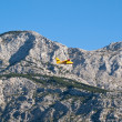 Airplane flying near mountain — Stock Photo