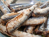 Fried anchovies on plate — Stock Photo
