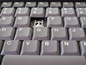 Broken button on grey keyboard — Stok fotoğraf