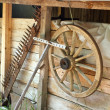 Old wooden house on farm with tools — Stock Photo