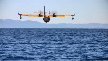 Fire fighter airplane landing at sea — Stock Video