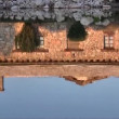 Reflection of stone house on water — Stock Video #13811658