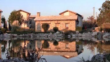 Stone house at lake — Stock Video