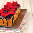 Cake loaf with rose petals — Stock Photo