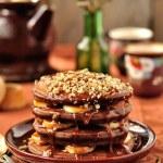 Chocolate Pancakes with Bananas and Caramel Sauce — Stock Photo #22214471