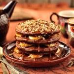 Chocolate Pancakes with Bananas and Caramel Sauce — Stock Photo