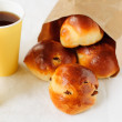 Sultana Buns in a Paper Bag with a Cup of Coffee, copy space for your text — Foto de Stock