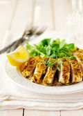 Sliced lemon herb crusted chicken breast, copy space for your text — Stock Photo