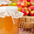 Canned Apple Juice and Apples in Basket — Stock Photo