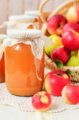 Canned Apple Juice and Apples in Basket, copy space for your text — Стоковое фото