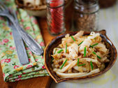 Fried Squid with Onions and Chives, vintage effect — Stock Photo